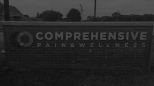 Comprehensive Pain and Wellness brick sign